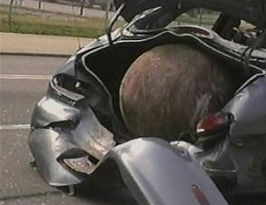 wrecking ball lands in trunk of car
