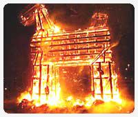 Swedish Christmas straw goat on fire