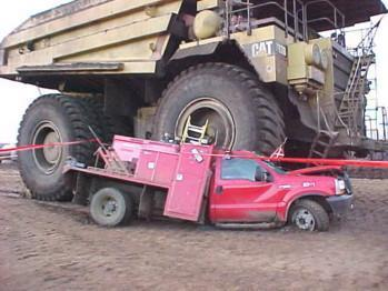 dump-truck-driving-over-pickup