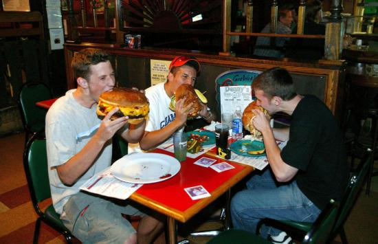 guys eating giant burgers