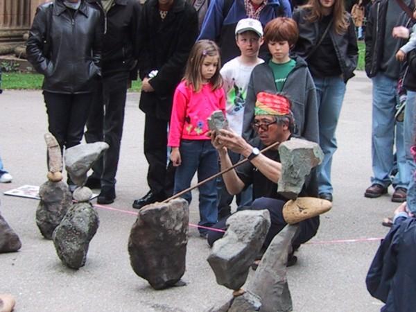man creating rock sculptures