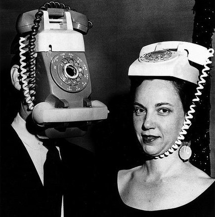 two people with phones on head