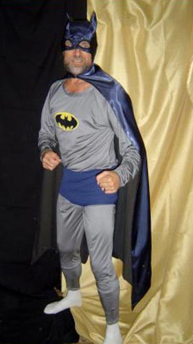 old man in Batman costume, missing parts