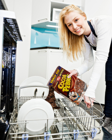 woman-loading-dishwasher-with-cocoa-pebbles