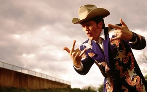 cowboy making hand gestures