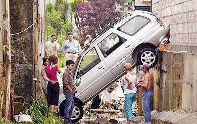 car between buildings